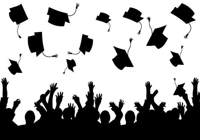 Graduates throwing caps in silhouette