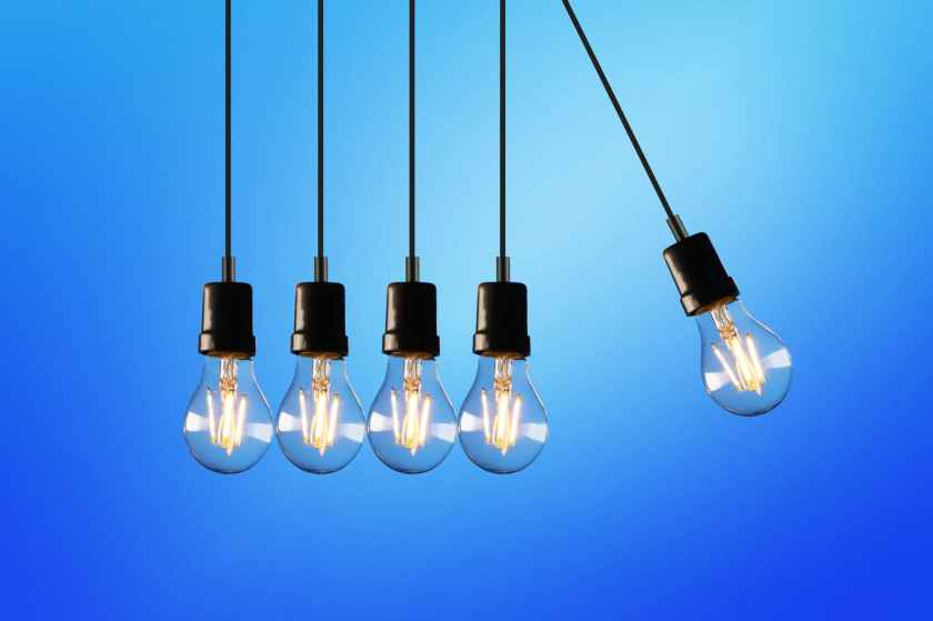 Five light bulbs hanging side by side.